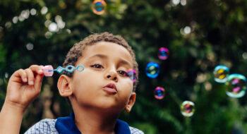 Boy playing soap bubble.